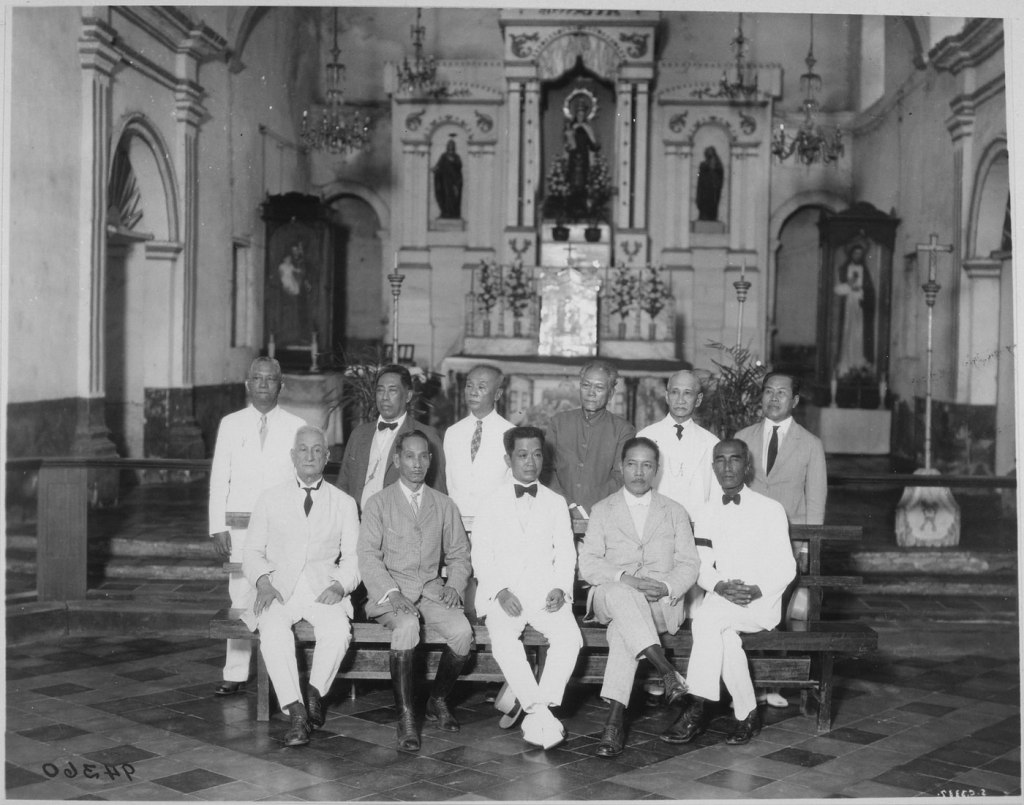 General Aguinaldo [seated, center] and ten of the delegates to the first Assembly of Representatives