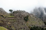 The dawn mist lifts above the terraced structures of Machu Picchu